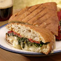 Green panini with roasted peppers and Gruyère cheese
