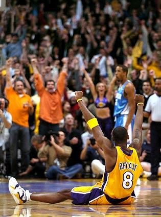 Kobe Bryant celebrates the game-winning shot against the Nuggets at Staples Center.