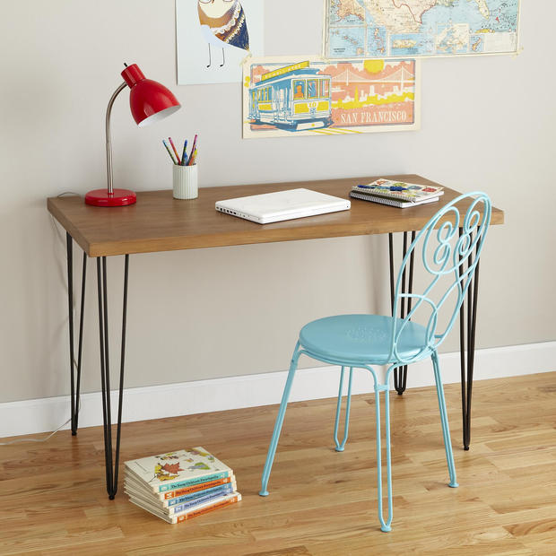 "Iron hairpin legs paired with a solid teak tabletop give the new Ansel Teak Desk a warm industrial look. It's $499 from the Land of Nod; <a href=""http://www.landofnod.com"">www.landofnod.com</a>."