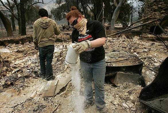 Tiffany Brain searches for anything of value of what's left after the Station fire destroyed her uncle's home in Big Tujunga Canyon.