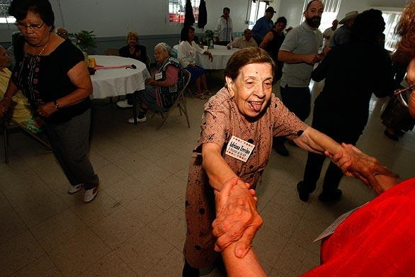 Adriana Trevino, 93, who has Alzheimer's disease, participates in a dance session at the  El Rinconcito del Sol Adult Day Care Center in Boyle Heights. Gov. Arnold Schwarzenegger is proposing to shut down the state's adult day healthcare centers, which provide services to help the elderly continue living at home. Also eliminated would be a program that funds Alzheimer's care at these and other centers.