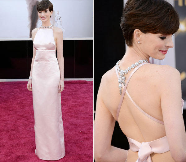 Anne Hathaway's icy pink duchesse satin Prada column gown made her look like a modern-day Audrey Hepburn (and wow, those Tiffany diamonds!). But Hepburn probably would have worn another layer underneath to keep things from popping up.