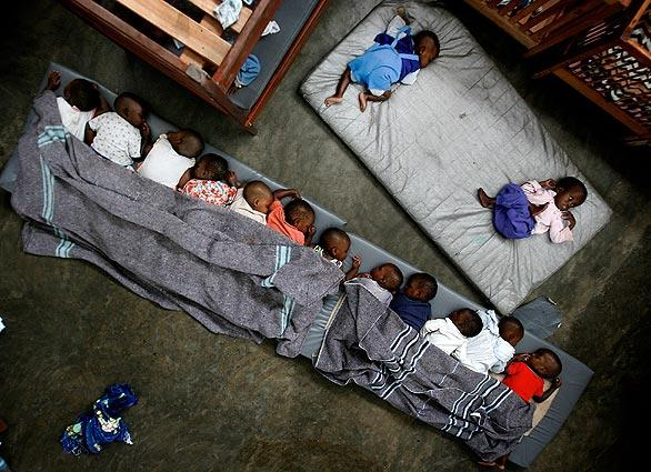 In this Nov. 13, 2008 file photo, motherless orphans and lost children rest at the Don Bosco Ngangi center in Goma, eastern Congo.