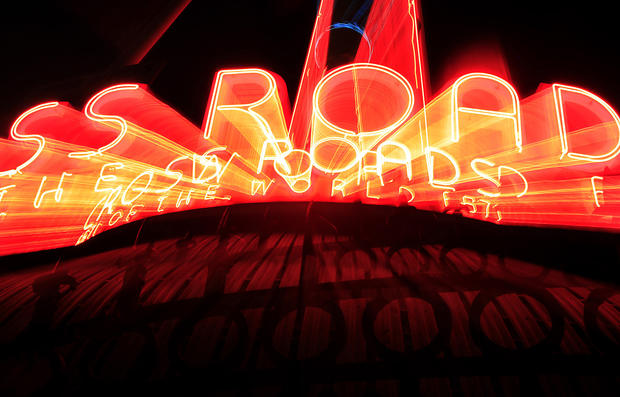 Neon lights up Crossroads of the World, Hollywood's landmark office complex that features a globe that has been spinning since 1936.