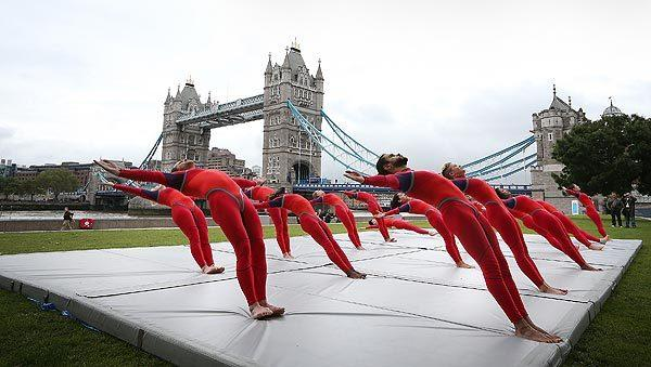 Elizabeth Streb's dancers perform in front of Tower Bridge in London as part of the Cultural Olympiad, a festival made up of 12,000 art and cultural events that honor the Summer Olympics. The troupe is from Brooklyn.
