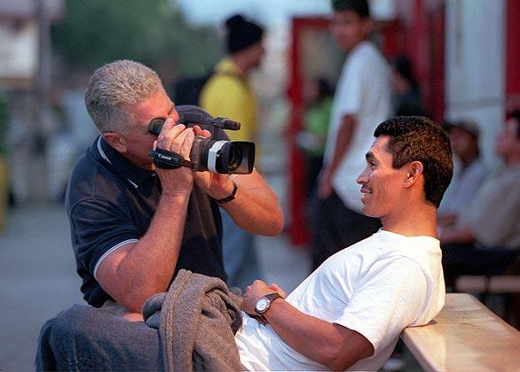 "Huell Howser interviews Armando Bonilla, a computer student at Evans Adult School at Figueroa Street and Sunset Boulevard in Los Angeles. ""I want the viewer to see what you would see with your eyes if you were there,"" Howser said."