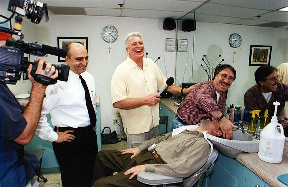 Huell Howser and crew during a segment in a hair salon.
