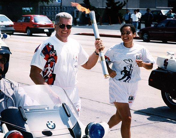 Running with the Olympic torch through Los Angeles for the 1996 Olympics.