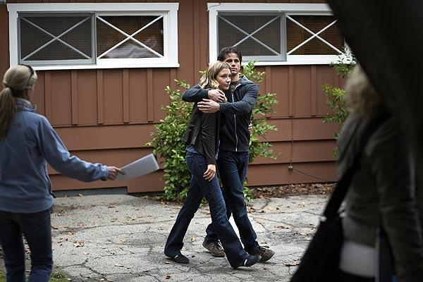Actress Sarah Roemer, left and Jason Ritter embrace after wrapping a scene.