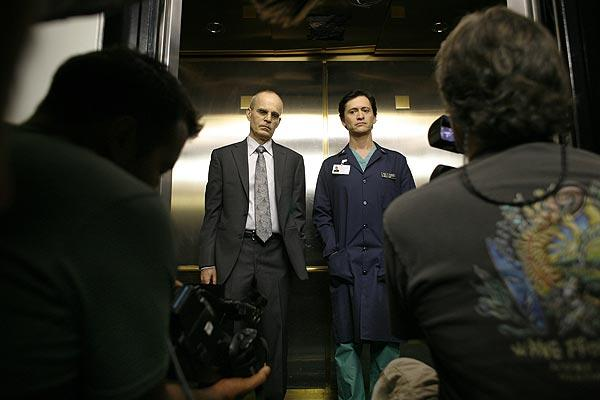Zeljko Ivanek, left, waits to perform a scene with Clifton Collins Jr,