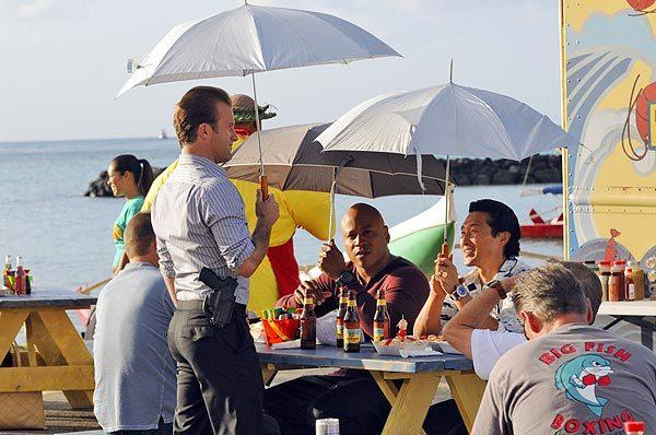 "Chris O'Donnell and LL Cool J of ""NCIS: Los Angeles"" and Scott Caan and Daniel Dae Kim of ""Hawaii 5-O"" find some shade between takes in Hawaii while filming cross-over episodes of their respective series."