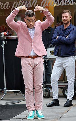 Robbie Williams filming his music video on location at Spitalfields Market in London.