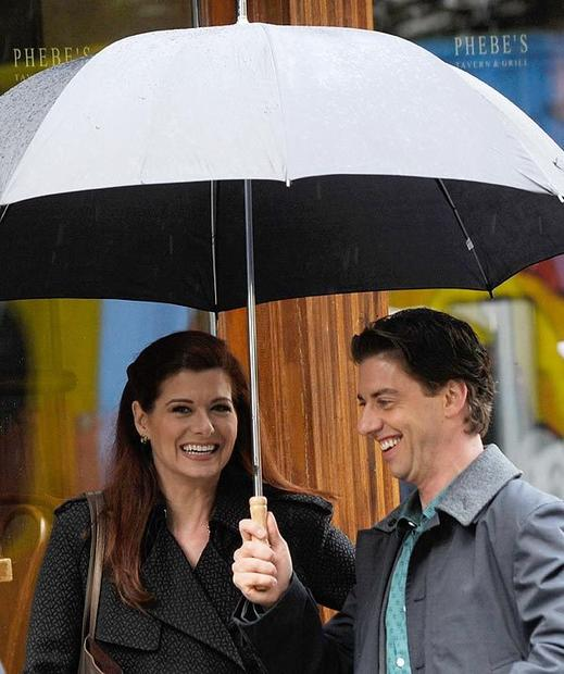 "Debra Messing and Christian Borle on location in New York City for ""Smash."""