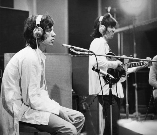 "Mick Jagger, left, and Keith Richards work in a recording studio July 30, 1968, during the filming of director Jean Luc Godard's film ""Sympathy For the Devil"" (a.k.a. ""One Plus One"")."