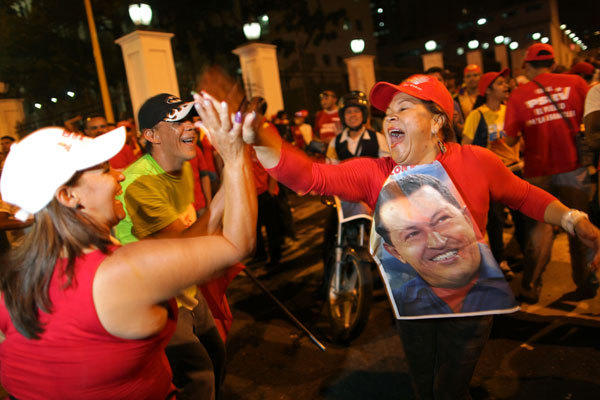 Chavez supporters cheer in Caracas in October 2012 after polling stations closed and Venezuela's electoral council said Chavez had won reelection.