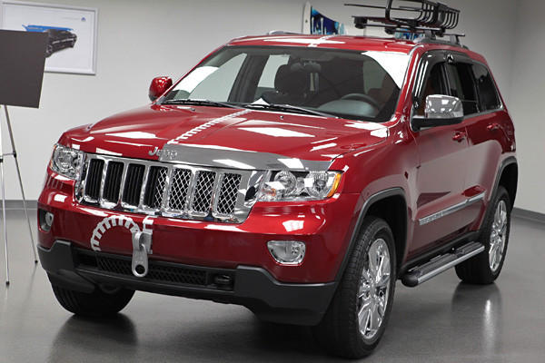 Jeep Grand Cherokee Half and Half: Think of this concept as one half normal, run-of-the-mill Jeep Grand Cherokee, one half over-chromed and hyper-accessorized nightmare from a spending bender at AutoZone. Chrysler Group says the aftermarket half shows of some of the thousands of parts available for Grand Cherokee owners, nearly all of which seems dripping in chrome. Taste sold separately.