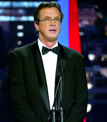 Michael Crichton presents an award at the 16th Annual Producers Guild Awards at Culver Studios in 2005. The writer-director shared a 1995 Academy Award for technical achievement for pioneering computerized motion picture budgeting and scheduling.