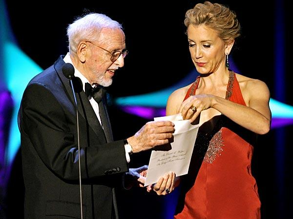 David L. Wolper, left, and actress Felicity Huffman present the David L. Wolper Producer of the Year Long-Form Television award during the 2006 Producers Guild awards at the Universal Hilton in Universal City. <br>