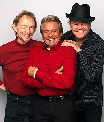 Peter Tork, left, Davey Jones and Micky Dolenz of The Monkees pose during a portrait session to announce the band's 45th anniversary tour held at the Groucho Club on Feb. 21, 2011, in London.