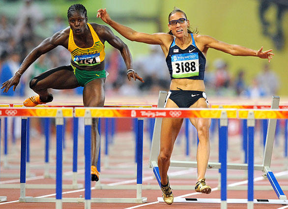 Lolo Jones of the United States tips over a hurdle while leading in the women's 100-meter hurdles. Jones finished seventh in the race.