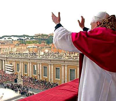 Pope Benedict XVI greets and blesses the crowd from the central balcony of St. Peter's Basilica.