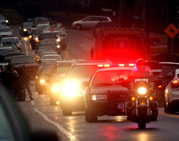 A hearse carries the body of Sandy Hook Elementary School student Jack Pinto, 6, to Newtown Village Cemetery.