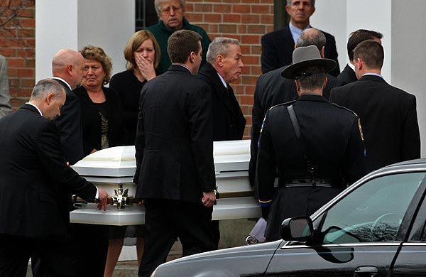 The casket of 6-year-old Jessica Rekos is carried to St. Rose of Lima Church in Newtown, Conn. Rekos was one of the 20 children killed in the Sandy Hook Elementary School shooting on Friday.