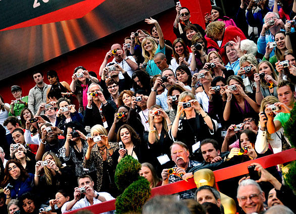 Fans waste no time or film as they capture Oscar night.