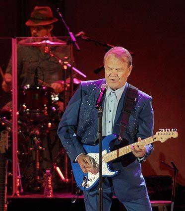 Glen Campbell performs at the Hollywood Bowl on June 24, 2012, as part of his goodbye tour. Before Campbell, who announced in 2011 that he was living with Alzheimer's disease, took the stage Sunday evening, a cast of singing admirers lined up to pay homage. They included Lucinda Williams, Kris Kristofferson and Jackson Browne.