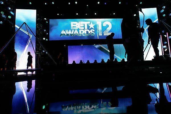 "Crew members work on the set for the 2012 BET Awards at the Shrine Auditorium. BET executives say that moving the show to L.A. Live next year will allow them to take it to ""the next level."""