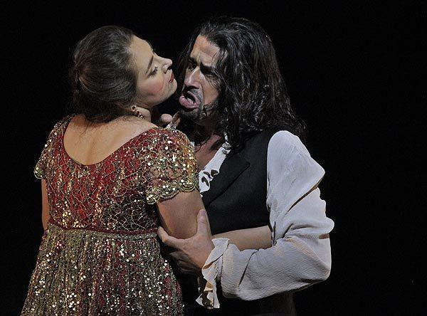 "Oksana Dyka as Tatiana and Dalibor Jenis as Eugene Onegin in Los Angeles Opera's production of ""Eugene Onegin"" at the Dorothy Chandler Pavilion."
