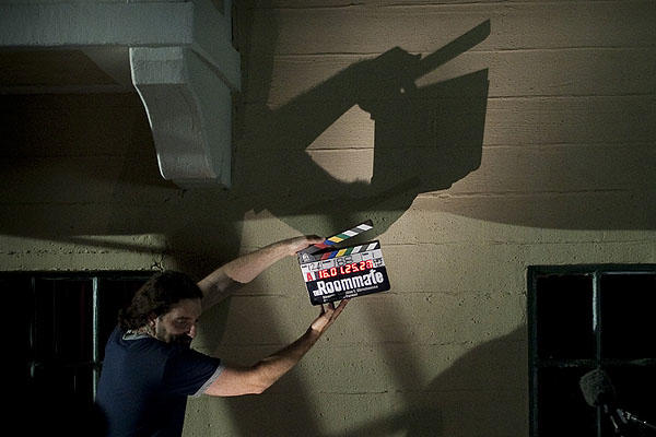 "The clapper's shadow is cast as a scene begins on the set of ""The Roommate,"" a thriller starring Leighton Meester, Minka Kelly and Cam Gigandet."
