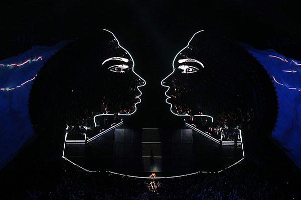 Beyonce performs as the stage makes light shapes behind her.