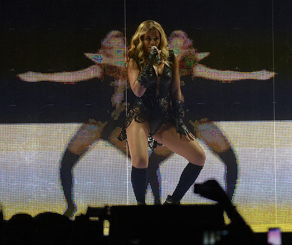 Beyonce uses background screens to, in a sense, multiply.