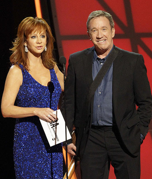 Reba McEntire and Tim Allen present the award for entertainer of the year.