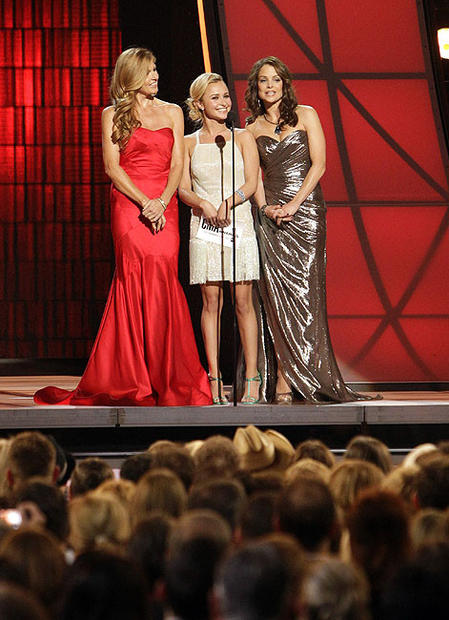 Connie Britton, left, Hayden Panettiere and Kimberly Williams-Paisley present the award for female vocalist of the year.