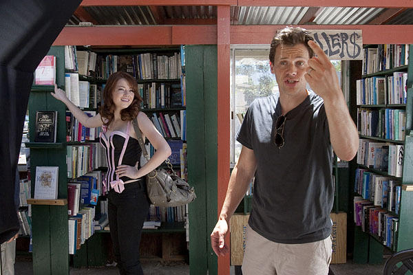 "Emma Stone watches as director Will Gluck discusses camera movements. ""Easy A,"" July 13, 2009"