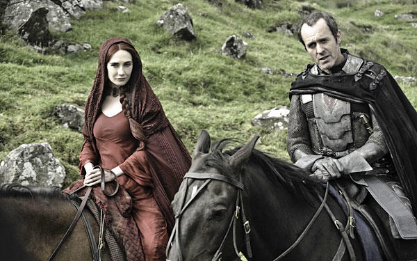 Melisandre of Asshai has come to the Seven Kingdoms filled with religion. Unfortunately, her kind of religion, worshiping the god R'Hllor, involves setting things on fire ... including people ... sometimes. Brooding Stannis Baratheon is willing to listen to the mysterious Melisandre because she wants nothing more than to put him on the Iron Throne, and he'd really like that too. Together, they're a dangerous duo. And they aren't shy about using force (and other things) to get their way.
