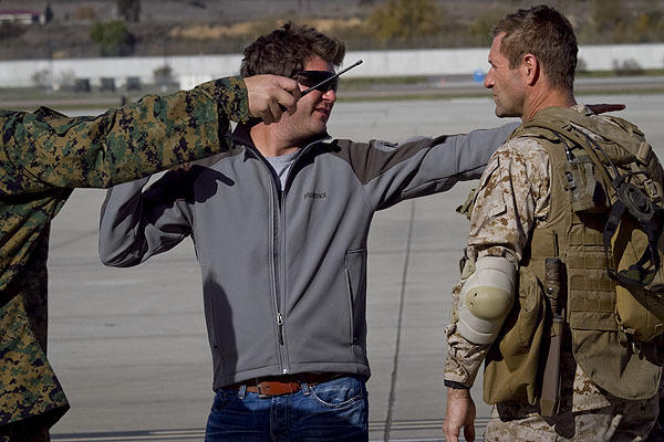 "Director Jonathan Liebesman gives direction to Aaron Eckhart during filming of ""Battle: Los Angeles."""