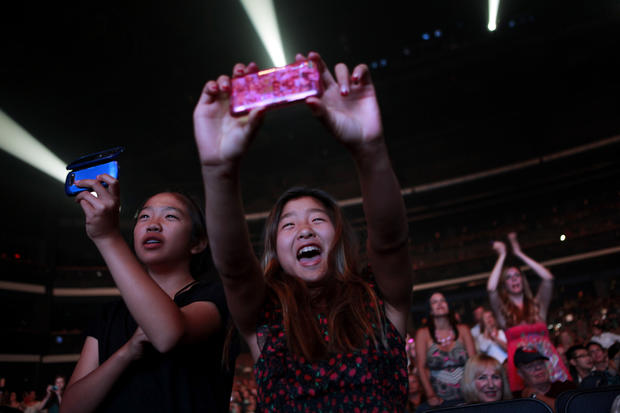 """American Idol"" fans take snapshots of the performers."