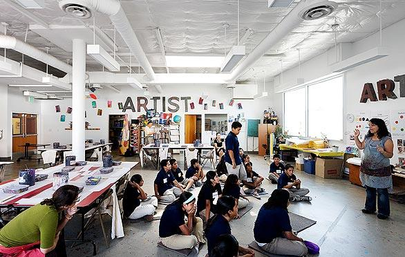 Students learn in a cheerful room, part of a campus that sits in an area of seafood and produce wholesalers, social service agencies, single-room-occupancy hotels and auto-parts shops.