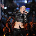 Miley Cyrus sparks marriage rumors, lights up 'Jolene'