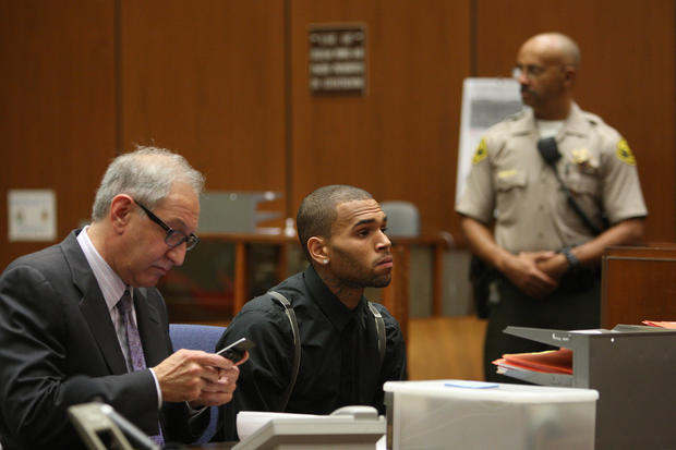 "Los Angeles County prosecutors on Tuesday accused singer Chris Brown of failing to complete his court-ordered community service for his 2009 assault conviction and questioned whether the documents submitted as proof of his service were fraudulent.  A motion filed by the district attorney's office said that Brown claimed he completed four hours of trash pickup between 10 a.m. and 6 p.m. on one day when he was actually on a private plane to Cancun that he boarded at 4 p.m. <br><br> Responding to allegations that his client faked fulfilling his community service, Brown's attorney accused Los Angeles County prosecutors Tuesday of making ""scurrilous"" statements against his client and said he plans to ask a judge to sanction prosecutors.  Mark Geragos told The Times he encouraged the Richmond Police Department to ""take legal action against the Los Angeles County district attorney,"" which alleged Tuesday that Brown violated his probation by not abiding by the terms of his court-ordered community labor in his home state of Virginia.  ""Apparently the district attorney's office has completely lost their minds,"" Geragos said. ""They are making scurrilous, libelous and defamatory statements and apparently have lost their ability to read their own reports.""  <br><br> <strong>Full story:</strong> <a href=""http://articles.latimes.com/2013/feb/06/local/la-me-chris-brown-20130206"">D.A. alleges Chris Brown failed to complete community service</a> 