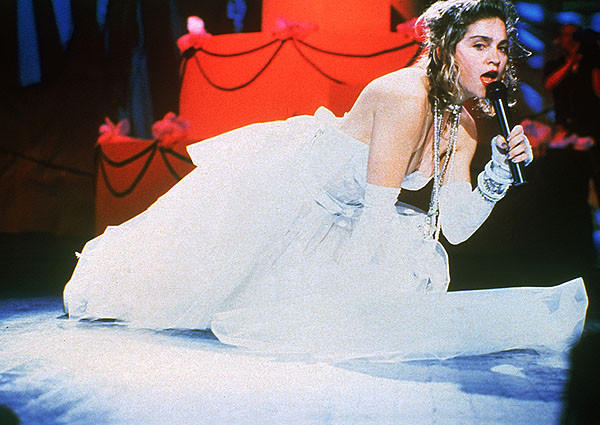 "At the inaugural award show, the Material Girl wowed the crowd atop a gigantic wedding cake for her performance of ""Like a Virgin."" Madonna wiped out any semblance of chastity with her antics in that tulle confection of a wedding gown."