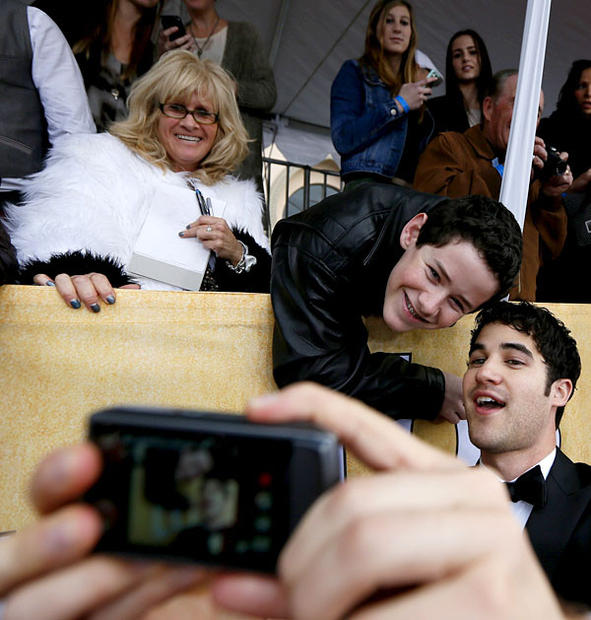 """Glee"" actor Darren Criss takes a photo with 16-year-old Woodland Hills fan Coby Hillborne."