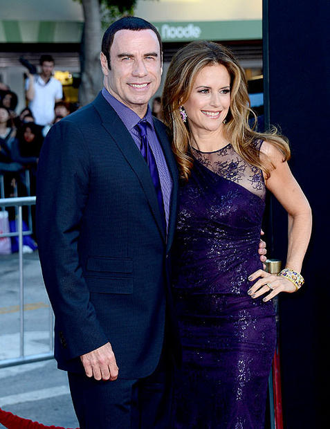 "Actor John Travolta, left, and actress Kelly Preston arrive at the premiere of ""Savages."" Travolta plays the corrupt DEA agent Dennis in the film."