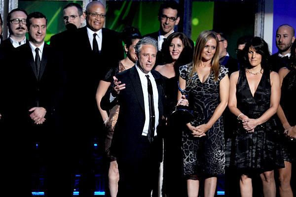 "Jon Stewart, center, is joined by writers and producers in accepting the Emmy for variety, music or comedy series for ""The Daily Show."""