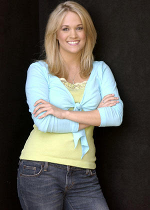 "<B>The girl next door</B><br> <br> Before Carrie Underwood won ""American Idol,"" she was the ultimate girl next door.<br> <br> Here, her worn-in jeans say, ""I'm fun.""  Her lacy cami and ballerina wrap say, ""I'm girly."" This is the Carrie Underwood you want to take home to Mom."