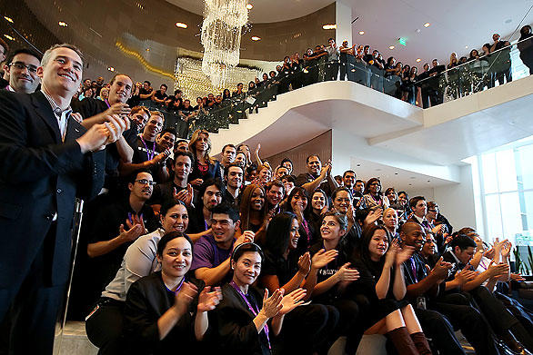 W Hotel employees cheer Gatehouse Capital Chief Executive Marty Collins as they gather for a photo in the lobby of the newly constructed Hollywood hotel. Collins was the force behind the creation of the ambitious mixed-use property that opens this week.