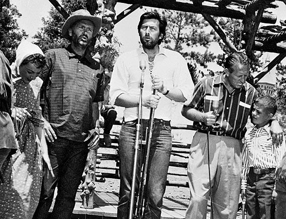 Parker, center, and actor Buddy Ebsen, left, rehearse for the opening day telecast at Disneyland in Anaheim in July 1955.